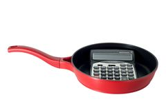 Calculator in frying pan Royalty Free Stock Image