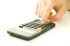 Calculator in gebruik Stock Fotografie