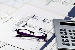Calculator and glasses Stock Photography