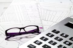Calculator and glasses Royalty Free Stock Images