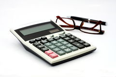 Calculator and glasses isolated on white background Stock Images