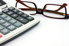 Calculator and glasses isolated on white background Stock Photography