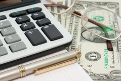 Calculator, glasses, notepad and money Royalty Free Stock Photography