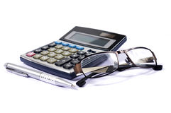 Calculator and glasses with a pen Royalty Free Stock Photo