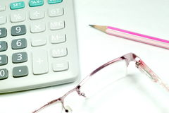 Stationery Set. Calculator Glasses Pencil for business concept royalty free stock image