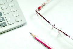 Stationery Set. Calculator Glasses Pencil for business concept royalty free stock photo