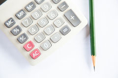Calculator, glasses, pencil and protractor scale. Royalty Free Stock Images