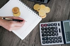 Calculator and golden bitcoin. Cryptocurrency investors concept. Royalty Free Stock Photos