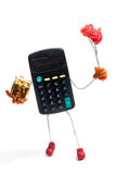Calculator with golden gift box and flowers Stock Photos