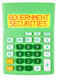 Calculator with GOVERNMENT SECURITIES on display Royalty Free Stock Photos