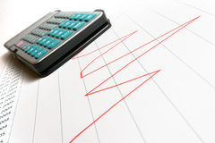Calculator on the graph Royalty Free Stock Photo