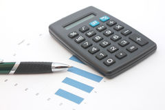 Calculator, graph with pen Stock Images