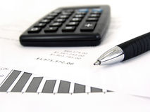 Calculator and graph with pen Stock Image