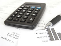Calculator and graph with pen Stock Images