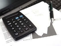 Calculator and graph with pen Royalty Free Stock Photos
