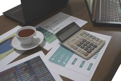 calculator and graph on the table with computer royalty free stock image