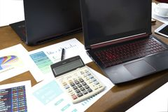 calculator and graph on the table with computer stock photo