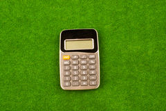 Calculator in green grass Royalty Free Stock Image