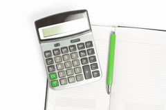 Calculator, green pencil and diary Royalty Free Stock Photos