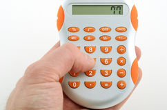 Calculator in hand Stock Photo