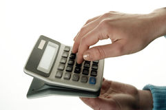 Calculator and hand Stock Image