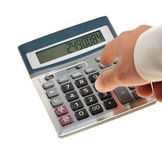 The calculator and a hand of the man Stock Photos