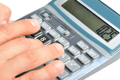 The calculator and a hand of the man Royalty Free Stock Photography