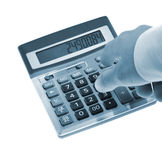 The calculator and a hand of the man Royalty Free Stock Image