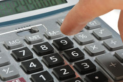 The calculator and a hand of the man Royalty Free Stock Images