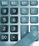 The calculator and a hand of the man Stock Image