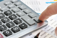 The calculator and a hand of the man Stock Photo