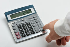 The calculator and a hand of the man Stock Photography