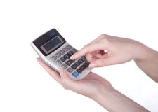 Calculator in hand. Calculator and money in hand on white Royalty Free Stock Images
