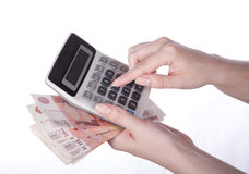 Calculator in hand. Calculator and money in hand on white Royalty Free Stock Image