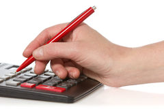 Calculator and hand with pen Royalty Free Stock Image