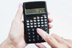 Calculator in hand Royalty Free Stock Images