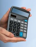 Calculator in hands. Royalty Free Stock Photos