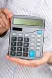 Calculator in hands. Stock Photos