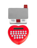 Calculator heart shaped and miniature house. Stock Photos