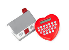 Calculator heart shaped and miniature house. Royalty Free Stock Photos