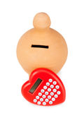Calculator and heart shaped pacifier. Stock Image
