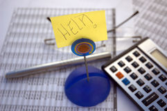 Calculator and help Stock Photography