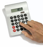 Calculator Help. A hand pushing a button on a calculator with help written on the screen Stock Image