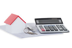 Calculator With House Model And Documents Royalty Free Stock Photos