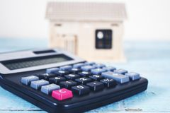 Calculator with house model royalty free stock photography