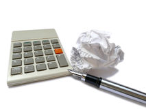 Calculator, ink pen and crumpled receipt ball Royalty Free Stock Images