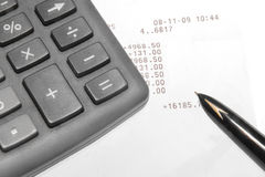 A calculator,  ink pen, and financial statement Stock Image