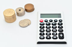 Calculator and japanese coin Royalty Free Stock Photo