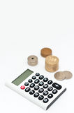 Calculator and japanese coin Stock Image