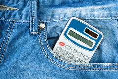 Calculator in jeans pocket Royalty Free Stock Photo